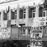 Black and white image of Lee Hall with student election banners hanging from the balconies.